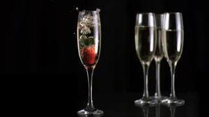 Strawberry diving in super slow motion into white wine