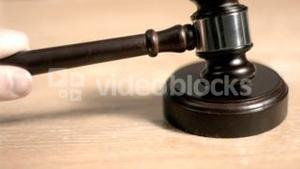 Gavel hitting in super slow motion a sound block