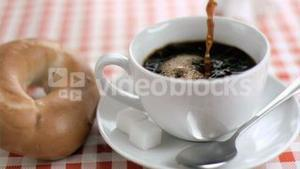 Coffee being poured in super slow motion in a cup