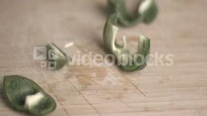Green pepper in super slow motion being cut