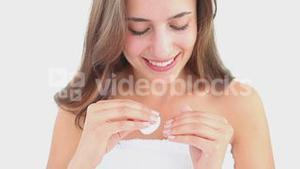 Happy woman using a nail polish remover