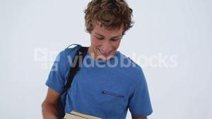 Happy young man holding his backpack