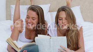 Friends reading books while listening to music together