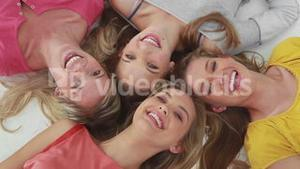 Happy young women lying together