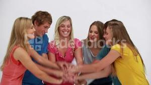 Happy friends joining their hands