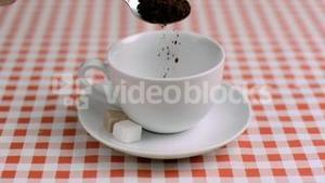Instant coffee poured in super slow motion