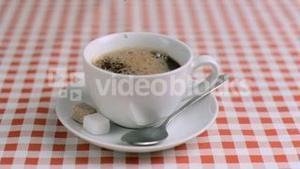 Water dripping in super slow motion into a cup