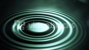 Drop falling in super slow motion on a water surface