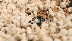 Popcorn cooking in super slow motion on a pan