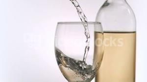 Wine been poured in super slow motion