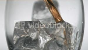 Glass with ice filled in super slow motion