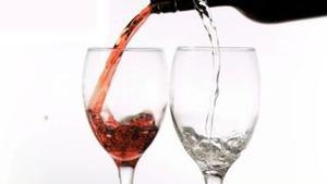 Wine poured in super slow motion in glasses