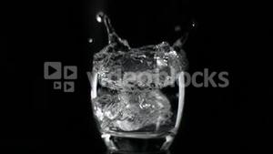 Ice cube falling in super slow motion in a limpid liquid
