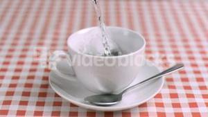 Water poured in super slow motion on a tea bag