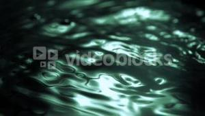 Green reflection in super slow motion on the water