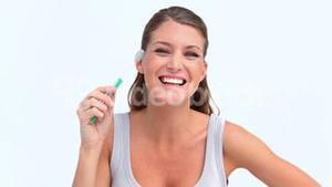 Woman brushing her teeth and smiling