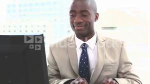 Happy businessman working on a computer