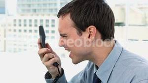 Businessman shouting on the phone