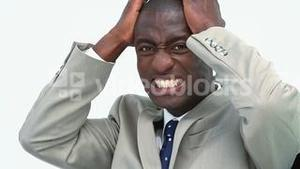 Businessman grimacing with the hands on his head
