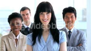 Happy business people standing upright together