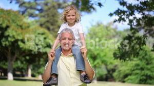 Man with his son on his shoulders