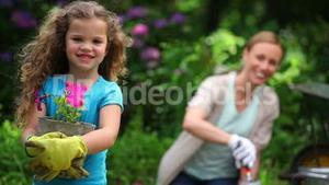 Mother and daughter planting flowers