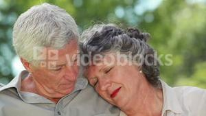 Mature man looking at his wife who is sleeping