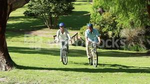 Happy couple riding their bikes together