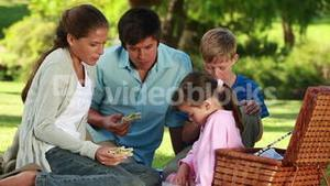 Happy family eating their sandwiches