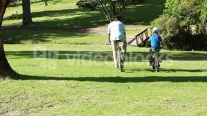 Father and son spending time together while riding bikes