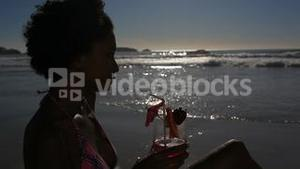 Woman drinking her cocktail with a straw