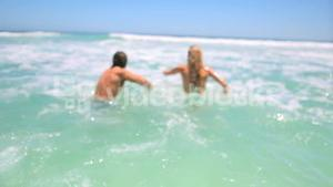 Couple swimming together