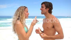 Couple eating watermelon together