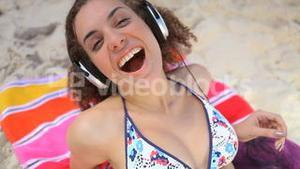 Woman listening to music and laughing