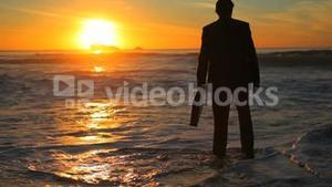 Man in suit walking to the sea