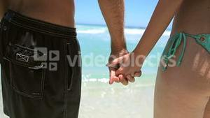 Couple holding each other hand