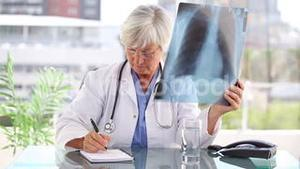 Thoughtful doctor holding an xray