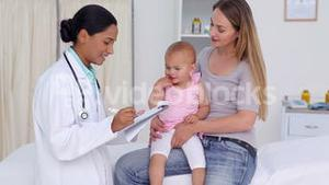 Doctor asking question about a baby