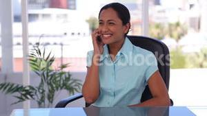 Happy woman picking up her mobile phone