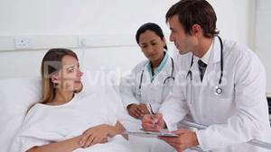 Doctor talking to a patient and then smile to the camera