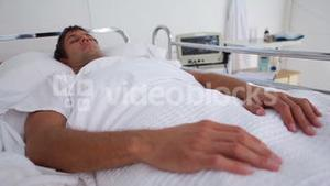 Unconscious patient lying in a sickbed