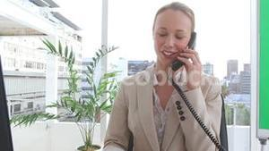 Businesswoman happy as she talks on the phone