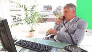 Businessman annoyed as he ends a call