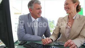 Two colleagues laughing together
