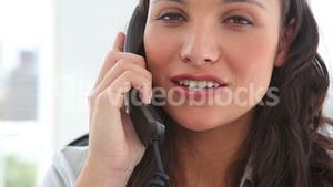 Happy businesswoman answering the phone