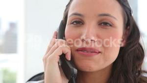Happy businesswoman making a call