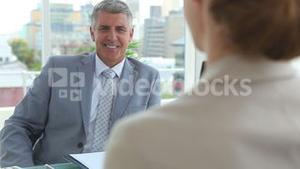 Businessman shaking hands with a woman