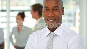 Business man smiling as the camera moves