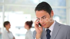 Business man looking worried while on the phone