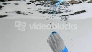 Brush in a super slow motion floating to the surface